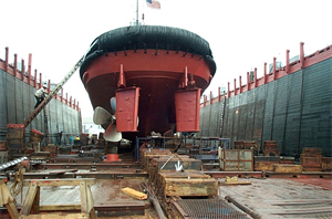 Tugboat in a dry dock for hull painting and propeller work at Caddell Dry Dock & Repair Co.