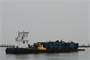 The first barge filled with Hurricane Sandy debris departs Point of Woods, N.Y., on Fire Island March 12, 2013. The U.S. Army Corps of Engineers is overseeing the removal of storm debris on Fire Island as part of the federal government's Hurricane Sandy response and recovery efforts. (U.S. Army photo by Chris Gray-Garcia/Released)